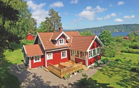 Rot-weißes Ferienhaus | Foto: Novasol